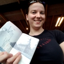 Morgan holding up her stamped passport at 5am in Iceland