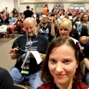 Morgan in a red top, showing the crowd at George RR Martin's panel