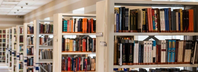Shelves full of books, in a decently lit library.