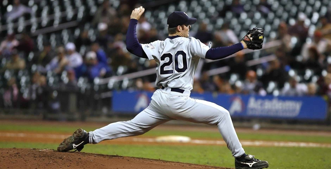 Player 20 winding up to throw a pitch.